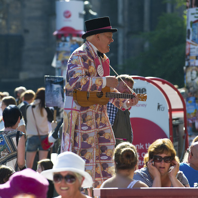 The High Street or Royal Mile in Edinburgh during the Fringe 2012 showing various street events and perfomances