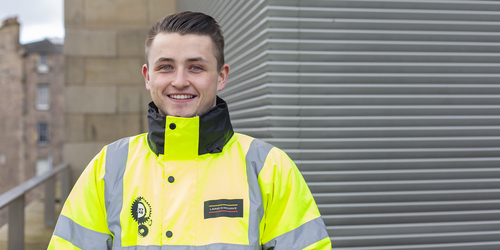 Quantity Student Evan Ramsay in a high vis