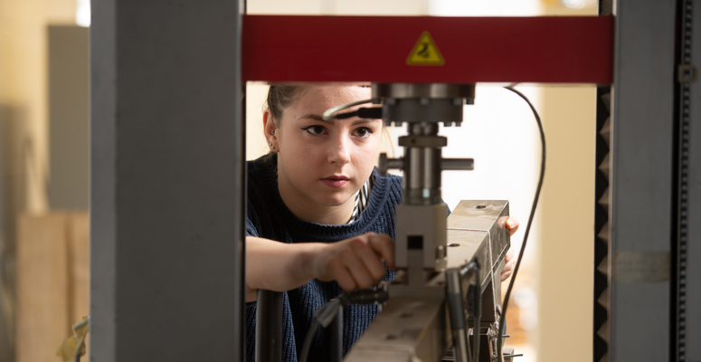 Louise Rodgers, a beX scholar, working on a machine