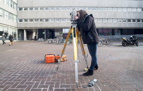 Student using surveying equipment