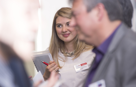 Photo of student with name badge at sales industry event