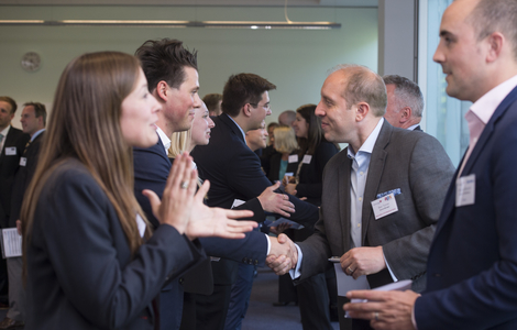 Photo of students meeting businessmen at industry event