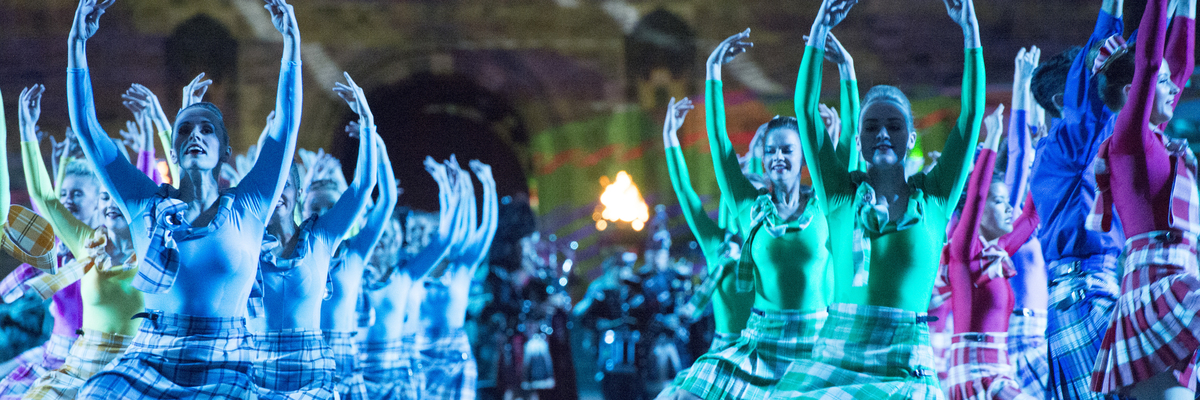 Traditional dancers performing in front of Edinburgh Castle at the Edinburgh Military Tattoo
