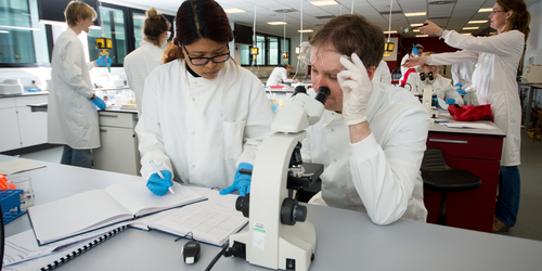 Students wearing labcoats