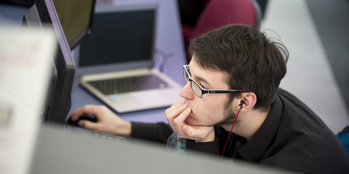 Student concentrating at a computer.