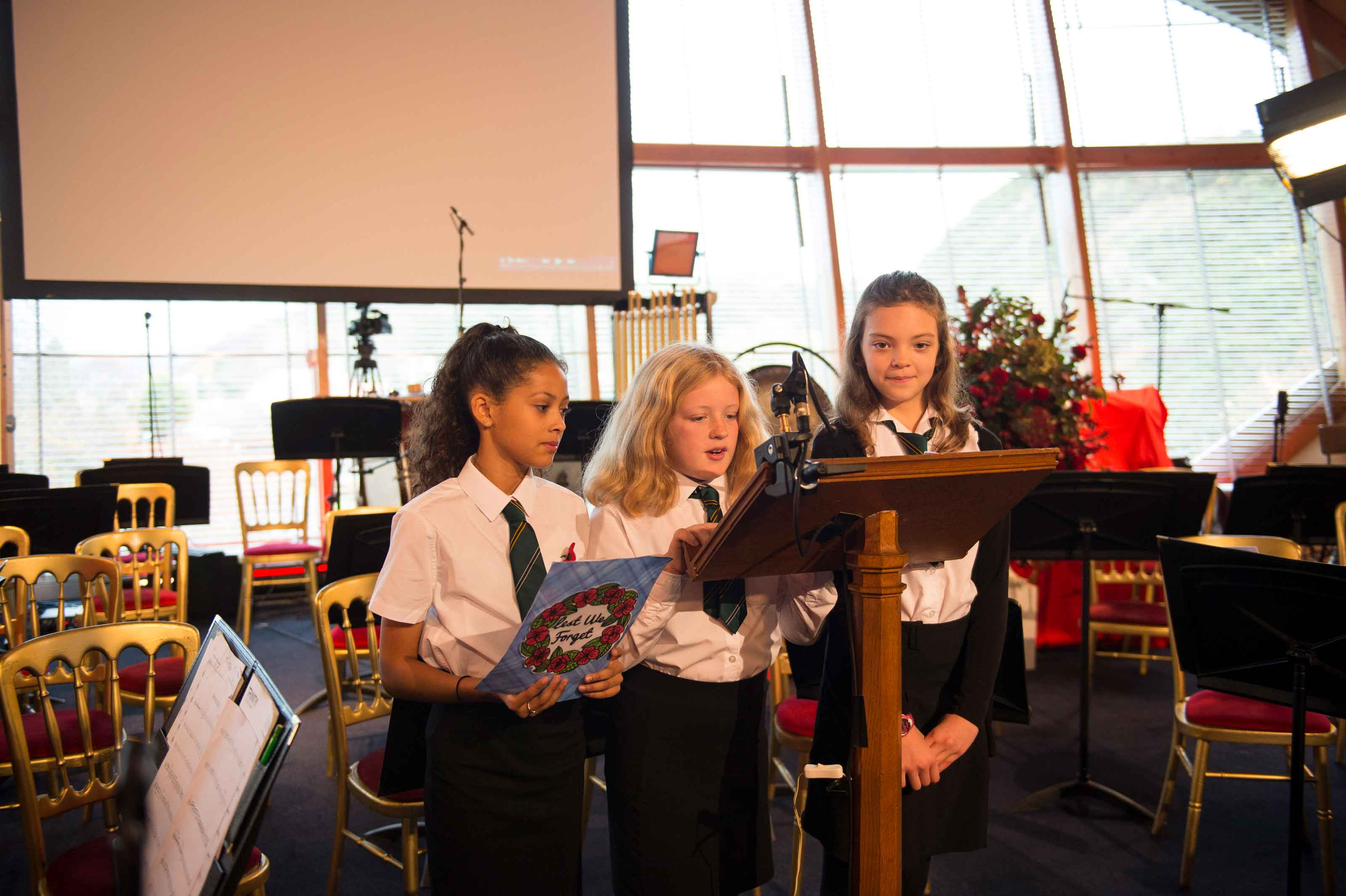 Pupils recite poetry at the Concert for Cooperation at Craiglockhart