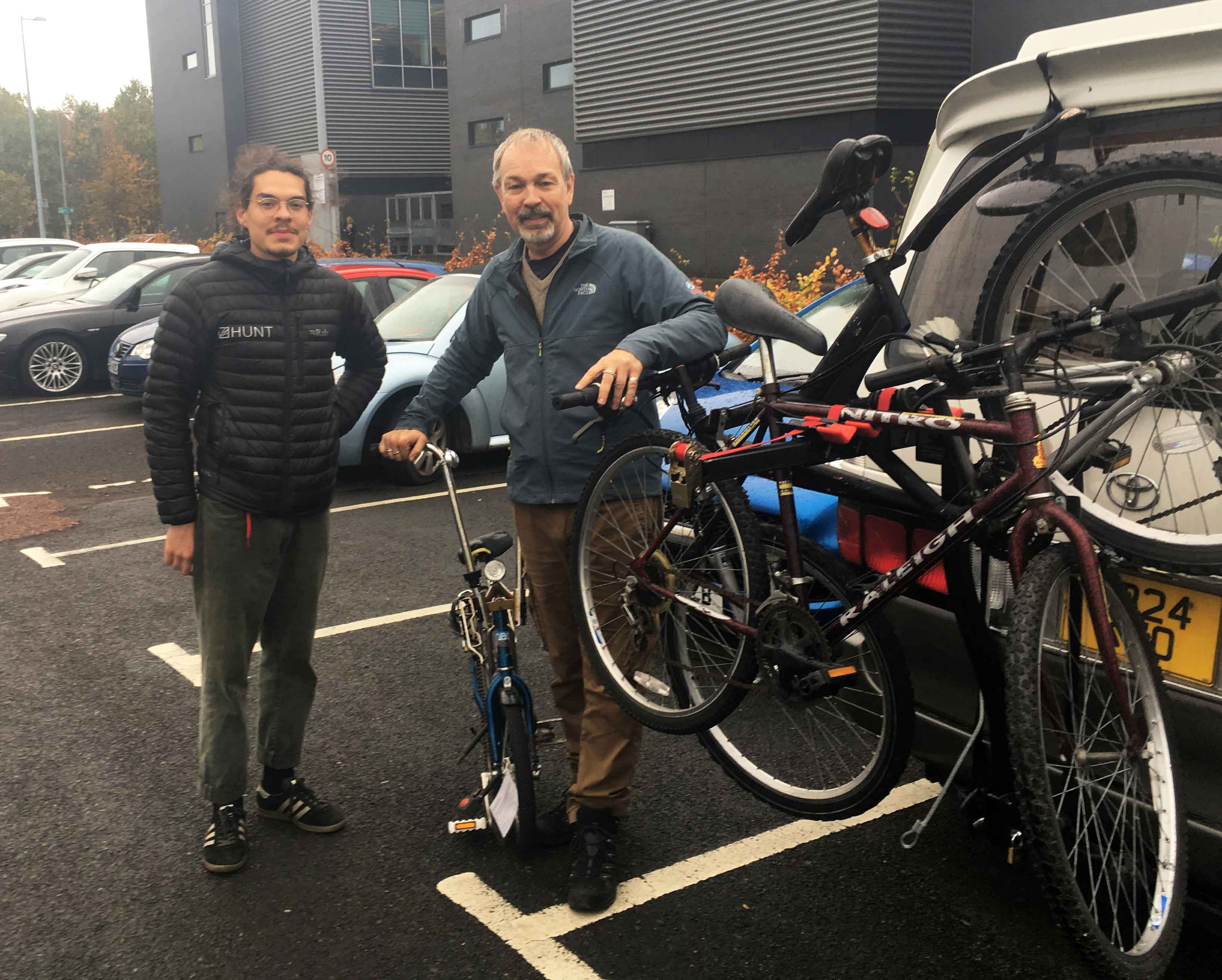 Mechanic Sharif Elsabagh and founder/director of Bikes for Refugees Scotland Steven McCluskey collect donated bikes at Edinburgh Napier's Sighthill campus