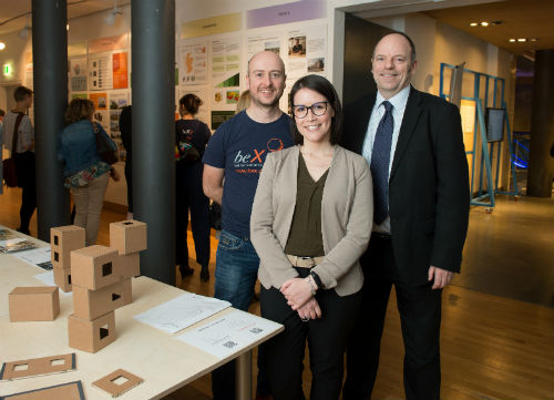 Professor Robert Hairstans, Head of the Centre for Offsite Construction + Innovative Structures within Edinburgh Napier's Institute for Sustainable Construction, research assistant Carola Calcagno, and Scottish Forestry's Andy Leitch at BeX exhibition.