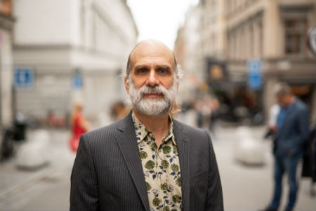 portrait of Bruce Schneier on a city street