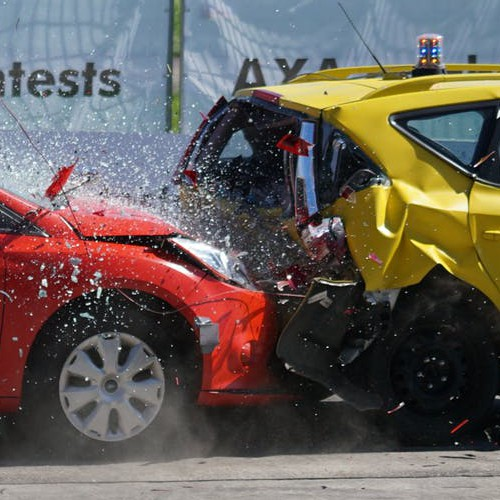 Close up image of one test car crashing into the back of another