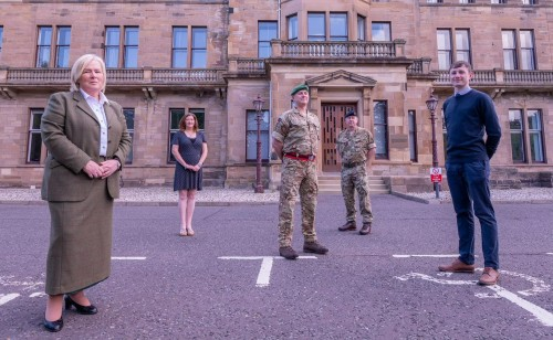 Socially distanced line-up of three civilians and two uniformed soldiers outside the old Craiglockhart military hospital