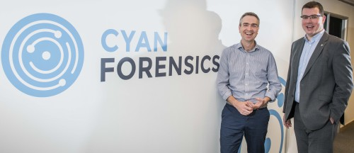 Ian Stevenson, CEO Cyan Forensics (right) with Paul Devlin, Investment Manager, Mercia Fund Managers, in front of company logo.