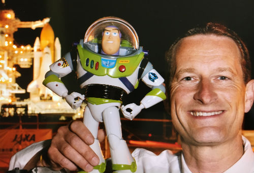 Duncan Wardle holding up Buzz Lightyear