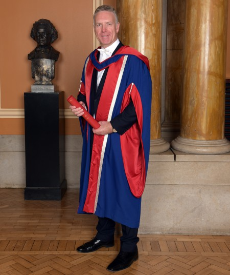 Mark Naysmith with degree scroll inside the Usher Hall