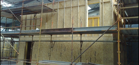 A prefabricated timber frame party wall