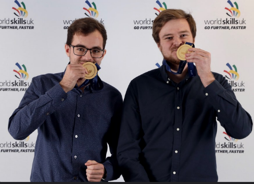 Jamie Fisher and Peter Hawker with gold medals at WorldSkills UK