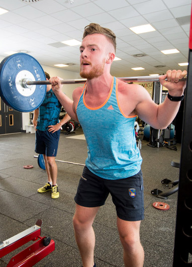 Student using weight training facilities at our Sighthill campus