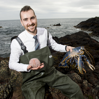 Student holding blue lobster