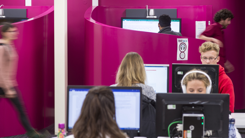 Students in the pink study pods area of Merchiston library